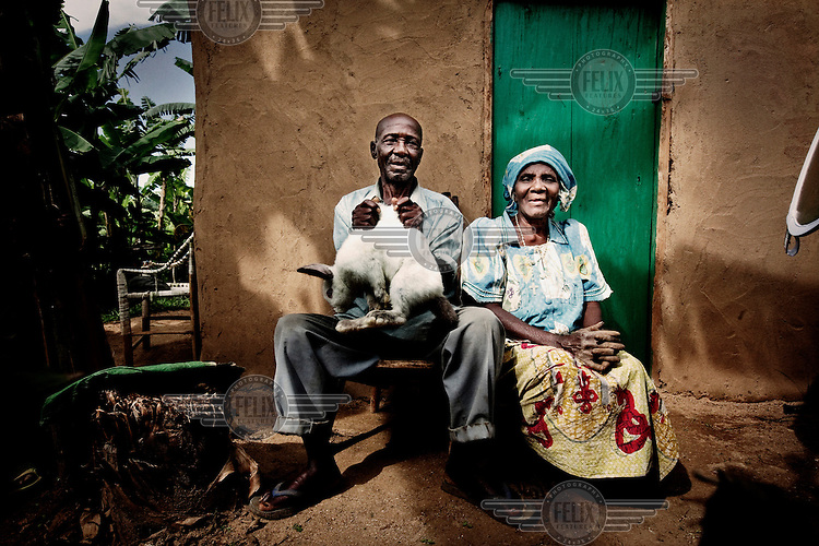 Brunot, 83, and Regina ,76, fled from the war in eastern Congo, and now make an income from raising and selling rabbits....