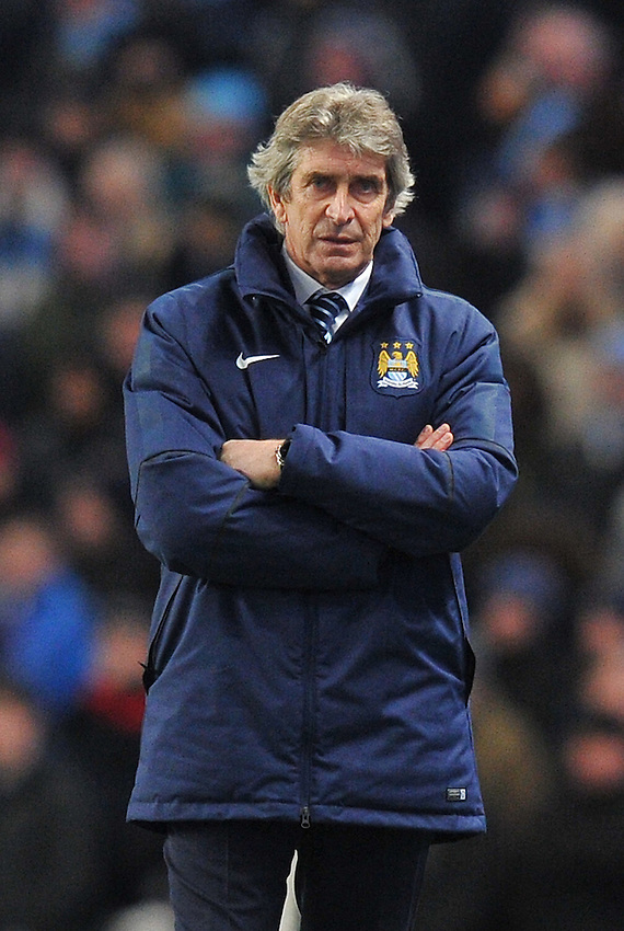 Manchester City's Manager Manuel Pellegrini looks dejected at the result<br /> <br /> Photographer Dave Howarth/CameraSport<br /> <br /> Football - Barclays Premiership - Manchester City v Arsenal - Sunday 18th January 2015 - Etihad stadium - Manchester<br /> <br /> &copy; CameraSport - 43 Linden Ave. Countesthorpe. Leicester. England. LE8 5PG - Tel: +44 (0) 116 277 4147 - admin@camerasport.com - www.camerasport.com
