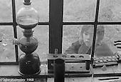 Looking in the window of the Science laboratory, Summerhill school, Leiston, Suffolk, UK. 1968.