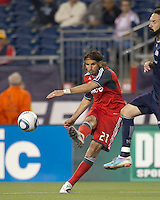 Toronto FC forward Alan Gordon (21) passes the ball. In a Major League Soccer (MLS) match, the New England Revolution tied Toronto FC, 0-0, at Gillette Stadium on June 15, 2011.