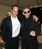 "Christopher Meloni, left, and Richard Belzer, right, stars of the NBC series ""Law and Order: Special Victims Unit"" arrive for the party  hosted by Bloomberg News following the 2003 White House Correspondents Dinner in Washington, DC on April 26, 2003..Credit: Ron Sachs / CNP"