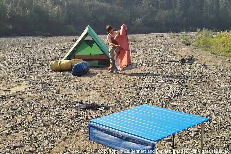 Georgia Bennett folds up the last of the sleeping gear at a camp along Beaver Creek.
