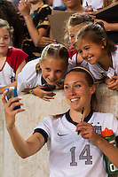 United States (USA) defender Whitney Engen (14) takes a selfie with some fans. The women's national team of the United States defeated the Korea Republic 5-0 during an international friendly at Red Bull Arena in Harrison, NJ, on June 20, 2013.