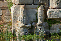 Close up of lower relief sculptures of Hittite gods at Eflatun Pınar ( Eflatunpınar) Ancient Hittite relief sculpture monument and sacred pool.  Between 15th to 13th centuries BC. Lake Beysehir National Park, Konya, Turkey.