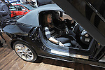 Women sit inside a bat mobile-like Mercedes at the Detroit Auto Show in Detroit, Michigan on January 11, 2009.