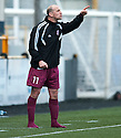 A bootless Arbroath player / manager Paul Sheerin shouts his instructions after substituting himself.