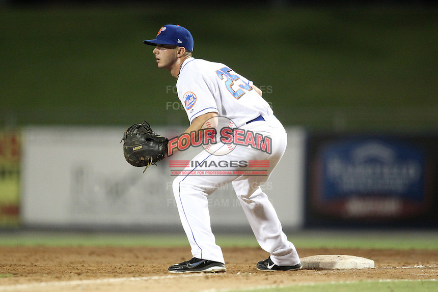 St. Lucie Mets first baseman Travis Ozga #25 during a game against the Charlotte Stone Crabs at Digital Domain Ballpark on June 20, 2011 in Port St Lucie, Florida.  St. Lucie defeated Charlotte 3-2 in 11 innings.  (Mike Janes/Four Seam Images)