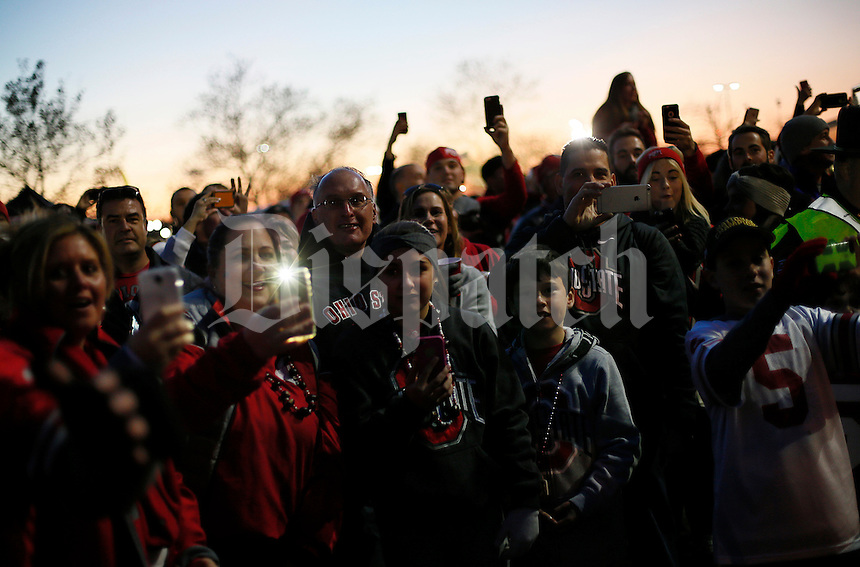 Fans try to catch a glimpse of the Ohio State Buckeyes as they head to the Skull Session in St. John Arena before the college football game between the Ohio State Buckeyes and the Minnesota Golden Gophers at Ohio Stadium in Columbus, Saturday night, November 7, 2015. (The Columbus Dispatch / Eamon Queeney)