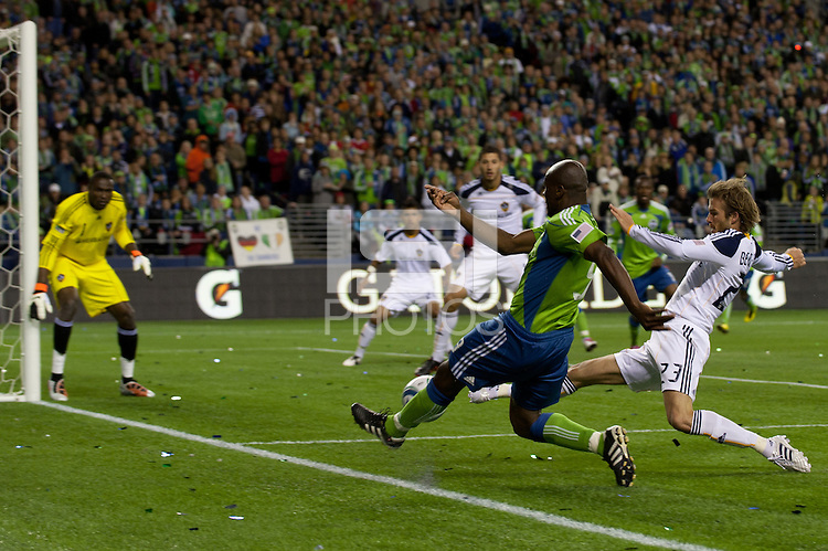 Blaise Nkufo (l) of the Seattle Sounders drives for the goal against Los Angeles Galaxy defender David Beckham (23) in the first game of the 2010 MLS Playoffs at the XBox 360 Pitch at Quest Field in Seattle, WA on October 31, 2010. The Galaxy defeated the Sounders 1-0.