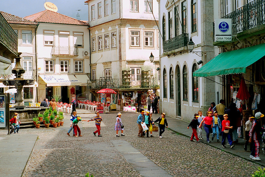 Portugal, Valenca. School group on outing to the fortaleza, or fortress, which houses many shops and cafes.
