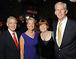 From left: Tom and Brenda Koch with Erin and Mike Lunceford at the Carmen and David Bridges Joyful Toyful Fiesta 19th Annual Holiday Toy Drive Party at Gigi's Asian Bistro & Dumpling Bar in the Galleria Tuesday Dec. 01,2009. (Dave Rossman/For the Chronicle)