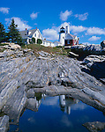 Lincoln County, ME<br /> Pemaquid Point Lighthouse (1835) reflected in a small pool in the granite rock forms of Pemaquid Point
