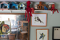 """Prototypes of her now famous """"Home Tweet Home"""" birdhouses stand on a shelf in Jada Fitch's living room, which doubles as her art studio, in Portland, Maine, USA, on Fri., July 28, 2017. Fitch has recently been making birdhouses that look like living rooms with small portraits of birds. The birdhouses sell out within minutes on her Etsy store. The birdhouses on the left are made of waterproof coroplast-like material and the green one on the right (center of frame) is similar to the final design she now produces."""