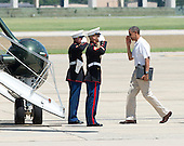 United States President Barack Obama salutes the U.S. Marine Guards as he prepares to board Marine 1 to depart Joint Base Andrews, near Camp Springs, Maryland for a weekend at Camp David following a round of golf on Friday, July 5, 2013.<br /> Credit: Ron Sachs / Pool via CNP