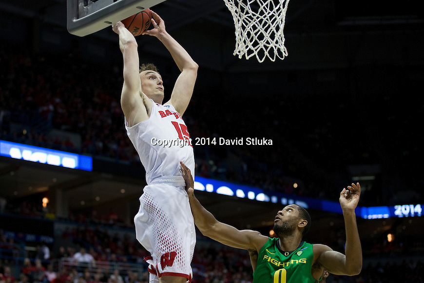 Wisconsin Badgers forward Sam Dekker (15) scores during the third-round game in the NCAA college basketball tournament against the Oregon Ducks Saturday, April 22, 2014 in Milwaukee. The Badgers won 85-77. (Photo by David Stluka)