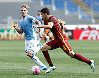 Calcio, Serie A: Lazio vs Roma. Roma, stadio Olimpico, 3 aprile 2016.<br /> Roma's Diego Perotti, right, is challenged by Lazio's Lucas Biglia during the Italian Serie A football match between Lazio and Roma at Rome's Olympic stadium, 3 April 2016.<br /> UPDATE IMAGES PRESS/Isabella Bonotto