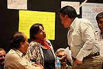Martin Esparza (R), secretary-general of the Electric Workers Union (SME) thanks Trinidad Ramirez, wife of political prisoner of Atenco Ignacio del Valle, her support during a workers' assembly to propose to build a national movement to oppose the Calderon's government decision and demanding to reverse the decision of the dissolution of the Luz y Fuerza del Centro (LFC) company, October 24, 2009. It also appears Jesús Martin del Campo at left.The Electric Workers Union (SME) is an union since 1914 and it has leadied historic workers struggles in Mexico. Photo by Heriberto Rodriguez