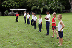 Central America, Costa Rica, Puerto Jiminez. Kids getting exercise at Esculea Carbonera, a small school nearby Lapa Rios.
