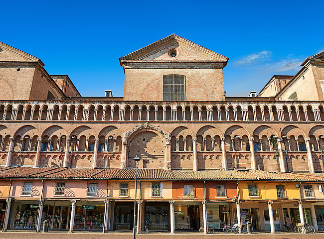 Medieval shops along the wall of the 12th century Romanesque Ferrara Duomo, Italy