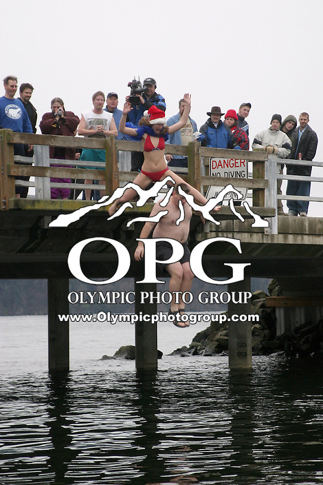 January 1, 2004:   Polar bear club members and people from through out the Pacific North West came out to watch and take part in the jumping off the Olalla bridge into the freezing New Years day ice cold salt water in Olalla, Washington.  The on going polar bear club has been jumping into the chilly waters since 1984 and this year marked the 20th anniversary.