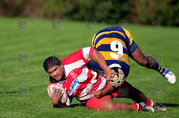 Karaka prop S. Atoa is taken to ground by P. Tuipuletu. Counties Manukau Premier Club Rugby, Patumahoe vs Karaka played at Patumahoe on Saturday 22nd April 2006. Karaka won 19 - 6.
