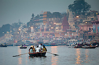 Traditional scenes of tourists on on River Ganges at Varanasi, Benares, Northern India
