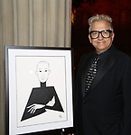 Ken Fallin with his drawing of Jason Wu attends 2017 Dramatists Guild Foundation Gala reception at Gotham Hall on November 6, 2017 in New York City.