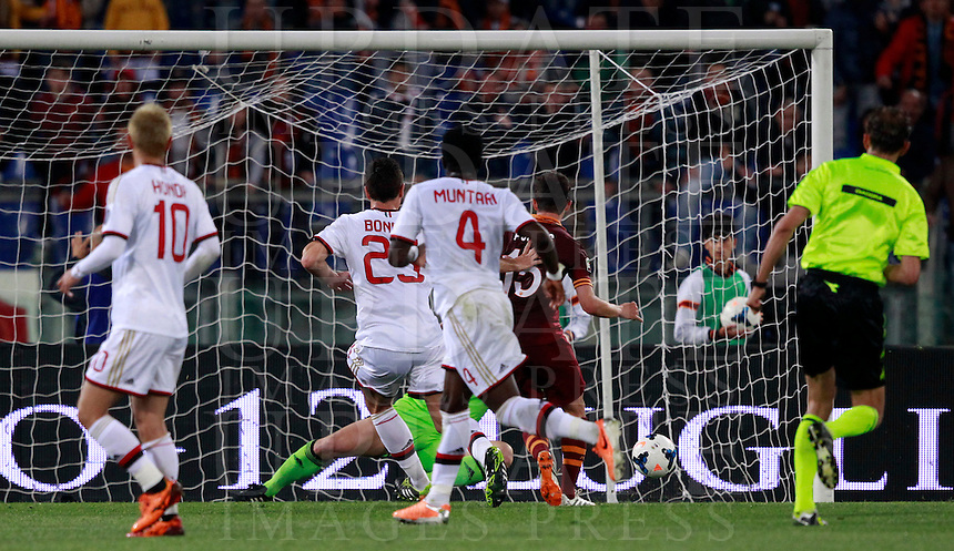 Calcio, Serie A: Roma vs Milan. Roma, stadio Olimpico, 25 aprile 2014.<br /> AS Roma midfielder Miralem Pjanic, of Bosnia, second from right, with red jersey, scores during the Italian Serie A football match between AS Roma and AC Milan at Rome's Olympic stadium, 25 April 2014.<br /> UPDATE IMAGES PRESS/Isabella Bonotto
