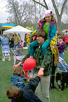 Father age 30 and kids ages 5 and 7. In the Heart of the Beast May Day Festival and Parade Minneapolis  Minnesota USA