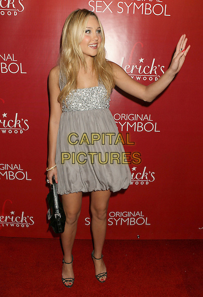 AMANDA BYNES.Frederick's of Hollywood Fashion Show held at the Hollywood Palladium, Hollywood, California, USA..October 24th, 2007.full length grey gray dress jewel encrusted silver black bag purse hand palm waving .CAP/ADM/RE.©Russ Elliot/AdMedia/Capital Pictures.