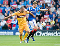 RANGERS' DORIN GOIAN TRIES TO GET AWAY FROM MOTHERWELL'S MICHAEL HIGDON