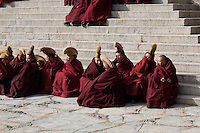 Monks of the philosophy college (esoteric studies) are closing their eyes while recitating mantras in the Great Assembly Hall of Labrang. After the demonstrations of march 2008, more than 150 of them have been arrested.