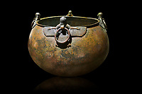 Phrygian bronze couldron with decorated winged figure handles . From Gordion. Phrygian Collection, 8th century BC - Museum of Anatolian Civilisations Ankara. Turkey. Against a black background
