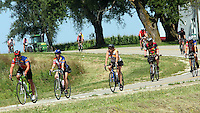 Riders make their way down a hill north of Lacona Wednesday on RAGBRAI XXXVII.