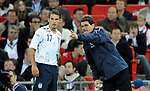 England manager Fabio Capello gives direction to David Bentley during the Friendly International match at Wembley Stadium, London. Picture date 28th May 2008. Picture credit should read: Simon Bellis/Sportimage
