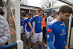 Wealdstone 0 Newport County 0, 17/03/2012. St Georges Stadium, FA Trophy Semi Final. The home players walking on to the pitch at St Georges Stadium, home ground of Wealdstone FC, before the club played host to Newport County in the semi-final second leg of the F.A. Trophy. The game ended in a goalless draw, watched by a capacity crowd of 2,092 which meant the visitors from Wales progressed by three goals to one to the competition's final at Wembley, where they would meet York City. The F.A. Trophy was the premier cup competition for non-League clubs in England and Wales affiliated to the Football Association. Photo by Colin McPherson.