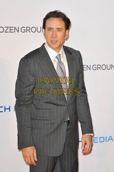 Nicolas Cage<br /> 'The Frozen Ground' UK film premiere, Vue West End cinema, Leicester Square, London, England.<br /> 17th July 2013<br /> half length white shirt purple suit grey gray suit pinstripe<br /> CAP/MAR<br /> &copy; Martin Harris/Capital Pictures
