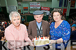 Denis Sheehan and Linda Daly presented John Lyne Kilgarvan a cake to celebrate his 80th birthday at the Mid Kerry Mart show and sale in Milltown on Saturday..