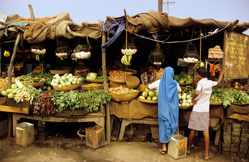 India. West Bengal. Fruit and vegetable stall at local market.