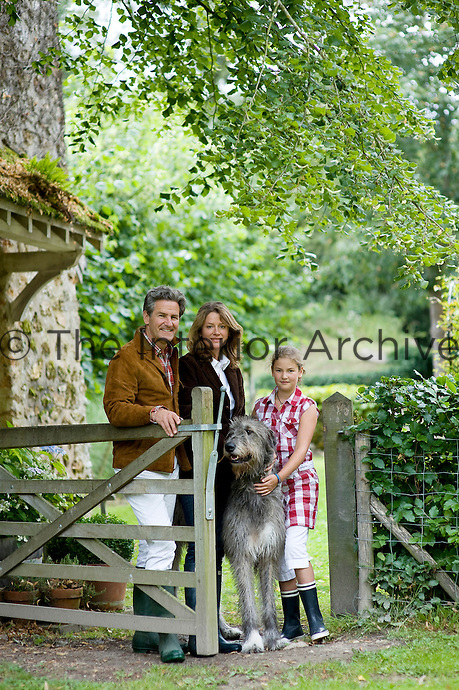 Patrick Deedes-Vincke, his wife Isabelle and their daughter Eleonore with Dune the Irish wolfhound