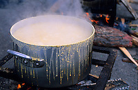 Polenta cooking on a stove on Mardi Gras, Belvedere, French Alps, France.
