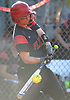 Bridget Kammerer #16 of Plainedge pulls her hands in to connect for a two-run single in the bottom of the fifth inning of a Nassau County varsity softball game against Island Trees at Schwarting Elementary School in North Massapequa on Monday, May 1, 2017. The hit extended the Red Devils' lead to 6-2. Plainedge scored a total of six runs in the frame and went on to win by a score of 10-5.