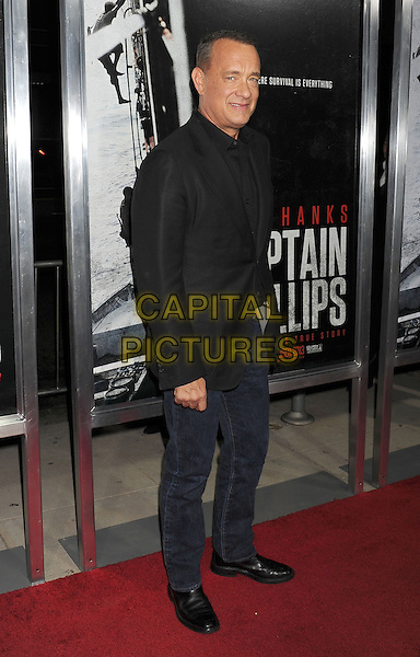 Tom Hanks<br /> Premiere of &quot;Captain Phillips&quot; held at the Academy of Motion Picture Arts and Sciences, Beverly Hills, California, USA.<br /> September 30th, 2013<br /> full length jeans denim black suit jacket shirt<br /> CAP/ROT/TM<br /> &copy;Tony Michaels/Roth Stock/Capital Pictures