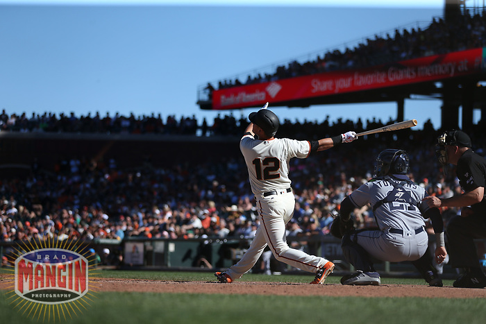 SAN FRANCISCO, CA - JULY 22:  Joe Panik #12 of the San Francisco Giants bats against the San Diego Padres during the game at AT&T Park on Saturday, July 22, 2017 in San Francisco, California. (Photo by Brad Mangin)