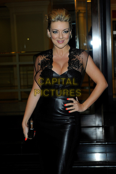Sheridan Smith.Royal Television Society Programme Awards held at the Grosvenor House, London, ENgland..March 19th, 2013.RTS half length black leather dress cleavage sheer lace clutch bag hand on hip orange nail varnish polish  .CAP/CJ.©Chris Joseph/Capital Pictures.