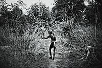 A Muria tribesman hunting rabbit with bow and arrow. Sukma, Chattisgarh, India. Arindam Mukherjee