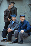 Senior men relaxing in a city park; Fuling, China, Asia; blue Mao caps; jacket; Fuling impacted by 3 Gorges Dam; 041703