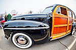 March 31, 2013 - Garden City, New York, U.S. - This 1946 Ford Super Deluxe 'Woodie' black and wood station wagon, owned by Bob Nelson of Glen Cove, NY, is at the 58th Annual Easter Sunday Vintage Car Parade and Show sponsored by the Garden City Chamber of Commerce. Hundreds of authentic old motorcars, 1898-1988, including antiques, classic, and special interest participated in the parade.