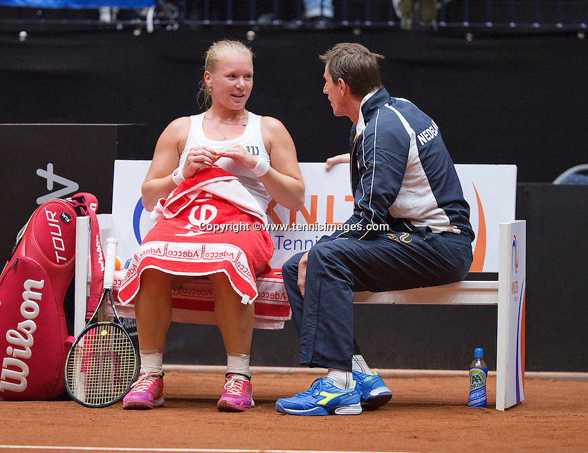 Netherlands, Den Bosch, April 18 2015 Maaspoort, Fedcup Netherlands-Australia,  Kiki Bertens (NED)  on the Dutch beng with captain Paul Haarhuis<br /> Photo: Tennisimages/Henk Koster