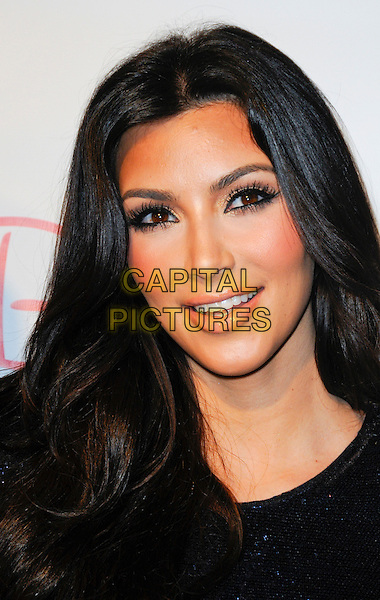 KIM KARDASHIAN .arriving at the Grand Opening of Beach Bunny Swimwear featuring the Kardashians for Beach Bunny line of swimwear in Los Angeles, California, USA, April 27th 2010..portrait headshot  blue navy make-up smiling eyelashes .CAP/ROT.©Lee Roth/Capital Pictures